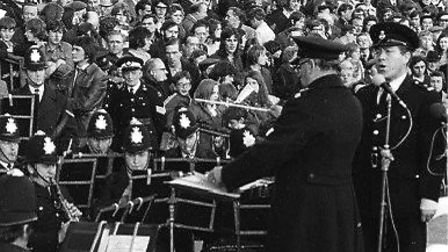 Constable Alex Morgan singing with the Metropolitan Police band at a Highbury game. Picture: family