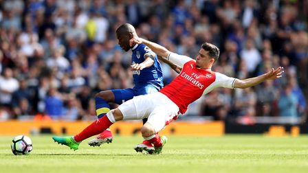 Arsenal's Gabriel Paulista (right) slides in on Everton's Enner Valencia (left) during their Premier