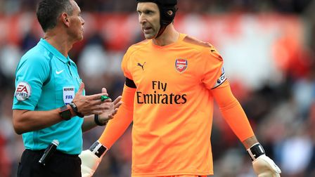 Arsenal goalkeeper Petr Cech speaks with referee Andre MArriner (pic Mike Egerton/PA)