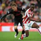 Arsenal's Aaron Ramsey (left) and Stoke City's Saido Berahino battle for the ball (pic Mike Egerton/