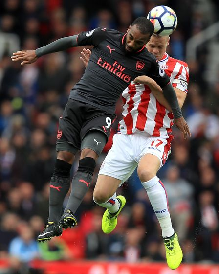 Arsenal's Alexandre Lacazette (left) and Stoke City's Ryan Shawcross battle for the ball (pic Mike E