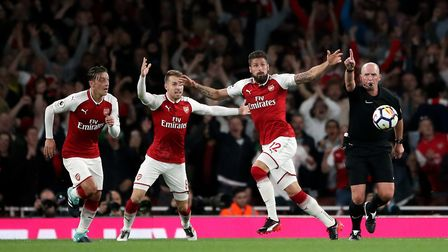 Arsenal's Olivier Giroud celebrates scoring his side's fourth goal of the game during the Premier Le