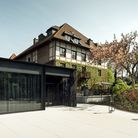 The modern extension next to the original building makes for a striking contrast