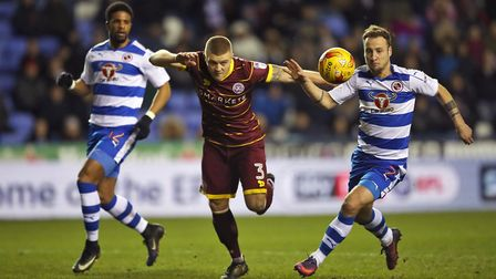 Jake Bidwell (centre) in action for Queens Park Rangers at Reading last season (pic: Nick Potts/PA)