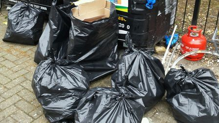 Black bin bags pulled out of a residential recycling site in Kingsdown Road by a council enforcement