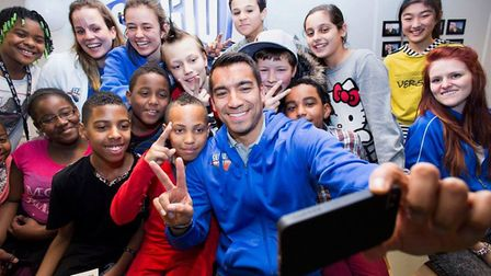Former Arsenal star Gio Van Bronckhorst with youngsters at a previous camp (pic Arie Kievit)