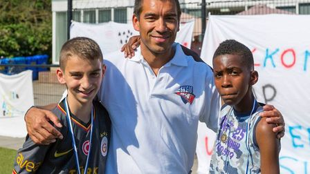 Former Arsenal star Gio Van Bronckhorst with youngsters at a previous camp