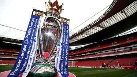 The Premier League trophy on display before the Premier League match at The Emirates Stadium, London