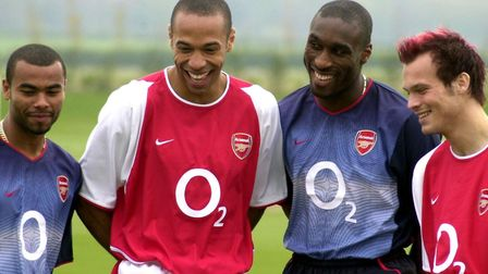 Ashley Cole, Thierry Henry, Sol Campbell, and Freddie Ljungberg model Arsenal's home and away strips