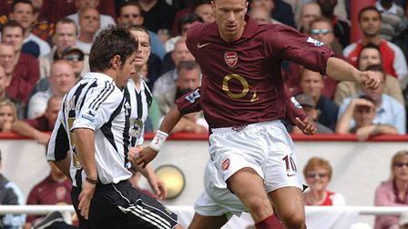 Dennis Bergkamp in action for Arsenal in 2005/06, when the Gunners had a limited edition dark red sh
