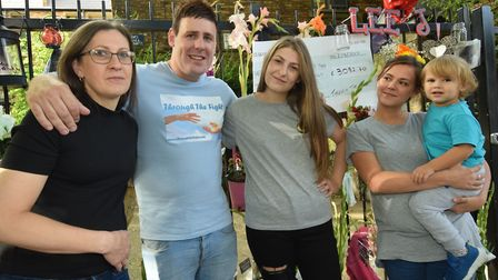 Shane Yerrell with the family of Lee Jay Hatley at his memorial wall in Barnsbury Street. From left: