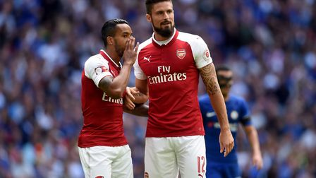 Arsenal's Theo Walcott and Olivier Giroud both converted in the penalty shoot-out against Chelsea to