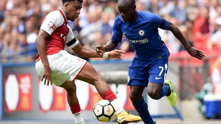 Chelsea's N'Golo Kante (right) and Arsenal's Alex Iwobi battle for the ball during the Community Shi