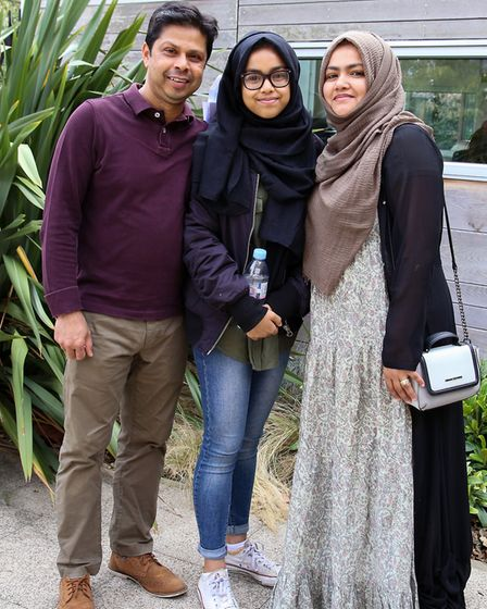 Abdus Shahid with his wife Tahera Begum and their daughter Sadia Shahid, centre, who achieved a 9 in