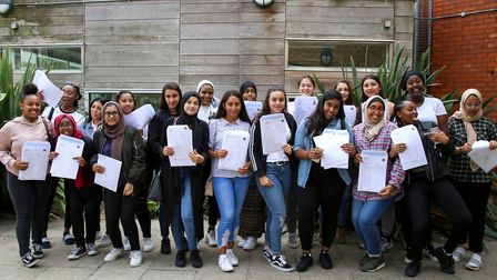 Girls at Highbury Fields School with their GCSE results, on 24th August, 2017. Picture: Catherine Da