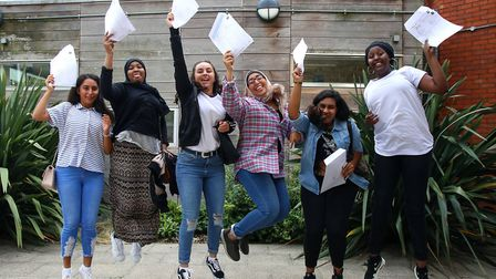 Students jump for joy at Highbury Fields School after receiving their GSCE results, on 24th August,