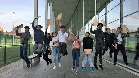 Pupils celebrate their GCSE results at Capital City Academy