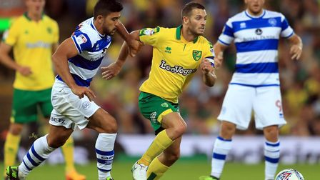 Norwich City's Wes Hoolahan (right) and Queens Park Rangers' Massimo Luongo (left) battle for the ba
