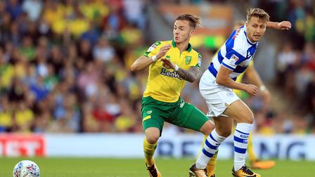 Norwich City's James Maddison (left) and Queens Park Rangers' Luke Freeman (right) battle for the ba