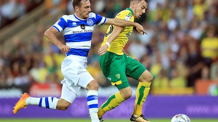 Norwich City's James Maddison (right) and Queens Park Rangers' Josh Scowen (left) battle for the bal