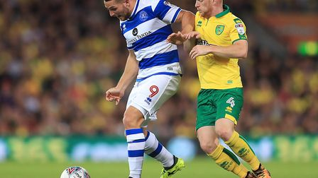 Norwich City's Harrison Reed (right) and Queens Park Rangers' Conor Washington (left) battle for the