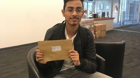 City of London Academy Islington student Mehrab Rahman celebrates his A-level results. Picture: Jame