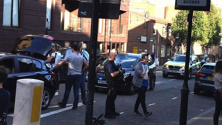 The scene in Elmore Street, Canonbury, on Wednesday evening after two men were arrested by armed pol