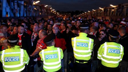 FC Koln fans and police outside the stadium prior to the Europa League match at The Emirates. Pictur