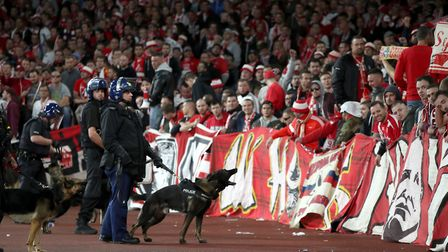 Police with dogs keep watch the FC Koln fans. Picture: Nick Potts/PA Wire