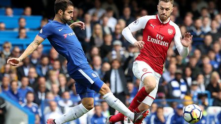 Chelsea's Cesc Fabregas (left) and Arsenal's Aaron Ramsey battle for the ball during the Premier Lea