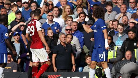 Chelsea's David Luiz (right) is shown a red card after a tackle on Arsenal's Sead Kolasinac during t