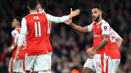 Theo Walcott with team-mates during the club's last domestic cup match at the Emirates, the 5-0 win