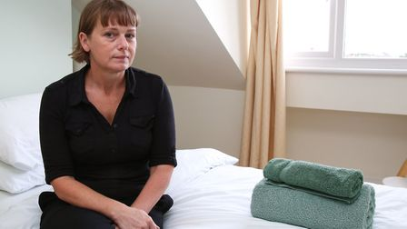 Maytree director Natalie Howarth sits in one of the bedrooms in the Maytree shelter. Picture: Cather