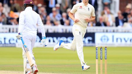 Middlesex's Toby Roland-Jones celebrates taking the wicket of Jermaine Blackwood during England's wi
