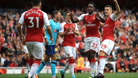 Arsenal's Danny Welbeck (second right) celebrates scoring his side's first goal of the game with tea