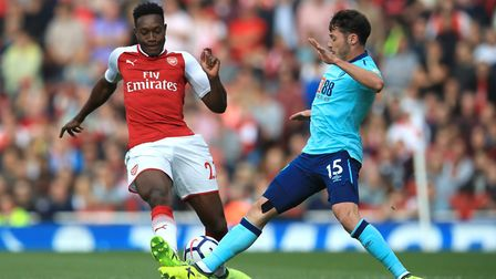 Arsenal's Danny Welbeck (left) and AFC Bournemouth's Adam Smith (right) battle for the ball during t