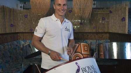 England's Tom Curran learns to play the steel drums at the Rum Kitchen ahead of England's limited-ov