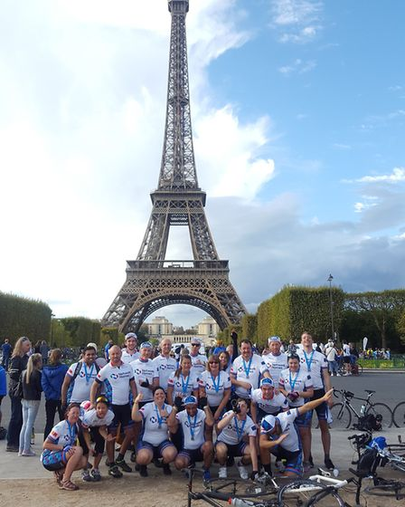 Twenty Network Homes cyclists at the 300 mile finish line by the Eiffel Tower