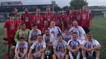 Danny's Boys and Team Payne face the camera at the annual memorial match for Islington's Danny Payne