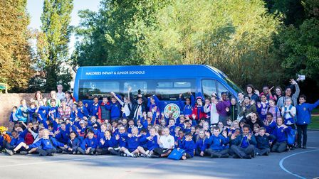 Malorees primary school pupils with their first ever mini bus (Picture: Sol Aizcorbe)