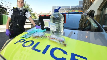 A police officer with the new acid attack response kit issued to response cars in Brent last weekend