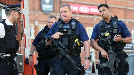 Police outside the Kia Oval ground in London, after play was suspended in the County Championship cl
