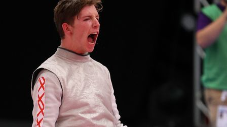 England's Dominic De Almeida celebrates winning the Mens Foil Final during the Fencing Competition d