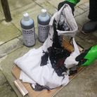 This t-shirt was badly scorched and burned, and completely dissolved in places, when strong acid dra