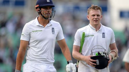 Sam Robson (right) walks off the field with then England captain Alastair Cook during a Test match a
