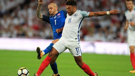Slovakia's Vladimir Weiss (left) and England's Alex Oxlade-Chamberlain battle for the ball during th