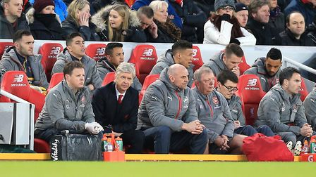 Arsenal manager Arsene Wenger (second left) looks on from the Anfield dugout last season (pic Peter