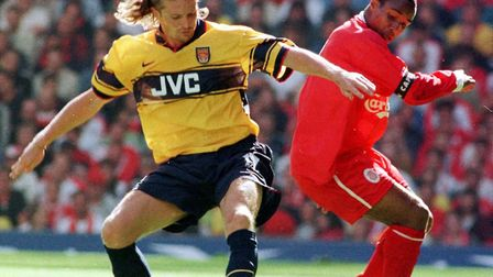 Arsenal's Emmanuel Petit battles with Liverpool's Paul Ince during their goalless draw at Anfield in