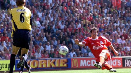 Liverpool's Robbie Fowler fires home against Arsenal at Anfield in 1999 (pic PA)