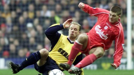 Arsenal's Dennis Bergkamp challenges Liverpool's Steven Gerrard during their clash at Anfield in 200